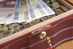 Treasure chest. Closeup of a treasure chest full of money Stock Photos