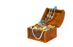 Treasure chest with bracelets, coins, rings and pearls Stock Photo