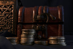 Treasure chest and candle Royalty Free Stock Photography
