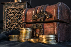 Treasure chest and candle Stock Photos