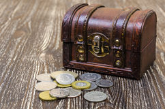 Treasure chest with coins, rare finds. Stock Photos
