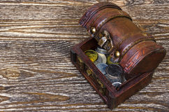 Treasure chest with coins, rare finds. Royalty Free Stock Photography