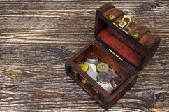 Treasure chest with coins, rare finds. Royalty Free Stock Photo
