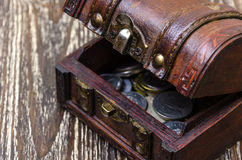 Treasure chest with coins, rare finds. Royalty Free Stock Images