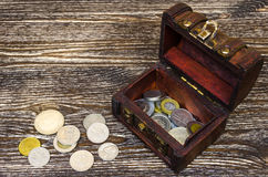 Treasure chest with coins, rare finds. Royalty Free Stock Image