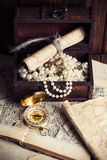 Treasure chest. Compass and old map on wooden table Royalty Free Stock Photo