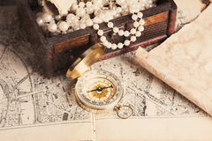Treasure chest. Compass and old map on wooden table Royalty Free Stock Images