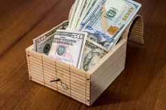 Treasure chest with dollars. On wooden background Stock Image