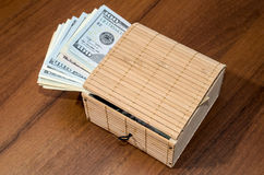 Treasure chest with dollars. On wooden background Royalty Free Stock Images
