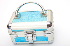 Treasure chest with doubloon. Close blue  treasure box  with jewelry on white Stock Image