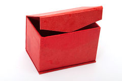 Treasure chest with doubloon. Close red  treasure box  with jewelry on white Stock Images