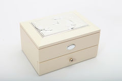 Treasure chest with doubloon. Close white  treasure box  with jewelry on white Stock Photography