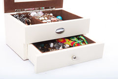Treasure chest with doubloon. Open white  treasure box  with jewelry on white Stock Image