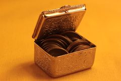 Treasure Chest. A few coins in golden box Royalty Free Stock Images