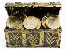 Treasure chest filled with coin, euro currency Stock Images