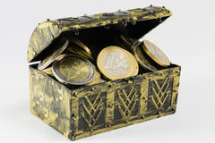 Treasure chest filled with coin, euro currency Stock Image