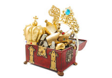 Treasure chest. Filled with golden objects  isolated over white Stock Photos