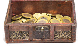 Treasure Chest. Front view of treasure box full of coins - focus on the chest royalty free stock photography