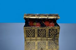 Open treasure chest full of colorful marbles royalty free stock photos