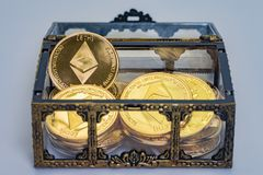 Etherium Treasure Chest. A treasure chest full of golden Etherium coins on a clean background Stock Photos
