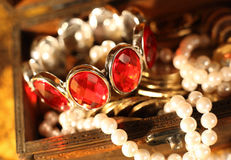 Treasure chest full of jewelry Stock Photos
