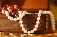 Treasure chest full of jewelry Royalty Free Stock Photo