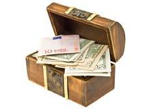 Treasure chest full of money Stock Photos