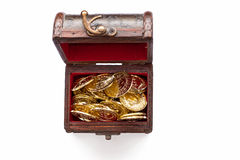 Treasure chest with gold coins on white. (toy royalty free stock photos