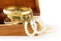 Treasure chest gold jewelry, bracelets. And pearl royalty free stock photo