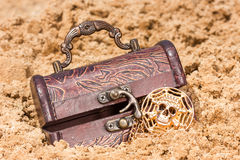 Treasure chest with the gold on a sandy beach. Pirate treasure chest with the gold on a sandy beach stock images
