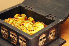 Treasure Chest. A treasure chest has been opened to reveal its abundant gold coins within Stock Photography