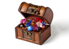 Treasure chest with jewelry. Open treasure chest with jewelry isolated on white Royalty Free Stock Photo
