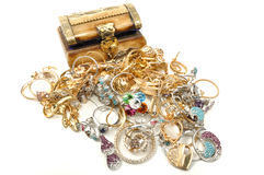 Treasure chest with jewelry. Wooden chest full of gold jewelry, isolated on white Royalty Free Stock Photos