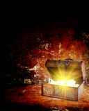 Treasure chest with jewelry inside. Against grunge background Stock Image