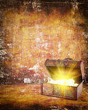 Treasure chest with jewelry inside. Against grunge background Royalty Free Stock Photo