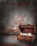 Treasure chest with jewelry inside. Against grunge background Stock Photography