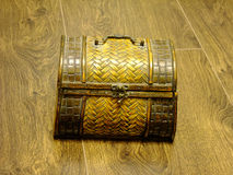 Treasure Chest. Little brown Treasure Chest closed on a dark wooden Floor Stock Images
