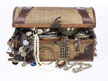 Treasure chest with lots of jewelry Stock Photos