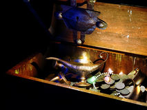 Treasure chest with magic lamp. A chest with doubloons, golden dishes, diamonds and a magic lamp Stock Image