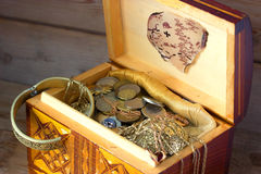 Treasure chest, old coins Stock Images