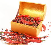 Treasure chest with pepper Stock Photos