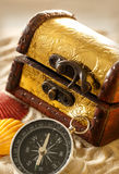 Treasure chest with seashells and compass Stock Photography