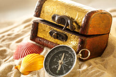 Treasure chest with seashells and compass Stock Image