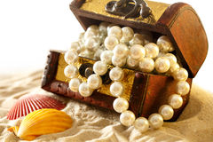 Treasure chest with seashells and pearl Royalty Free Stock Photo