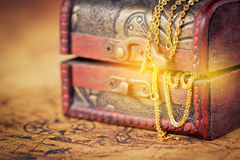 Old Treasure chest with shinny gold. Treasure chest with shinny gold on old map royalty free stock image