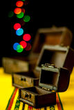 Treasure chests with blurred background treasure. Three treasure chests with blurred background treasure falling into the last one Royalty Free Stock Images