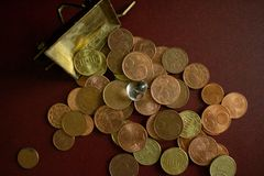A treasure of coins of money and a crystal gemstonee stock photo