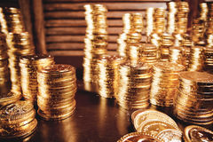 Treasure coins on table Royalty Free Stock Photos
