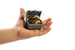Treasure hand. Isolated hand holding a small treasure (a bit 'of money Stock Image
