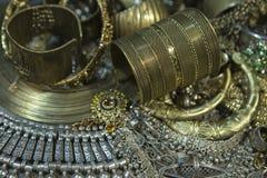 Treasure, heap of Beautiful Oriental Golden Bridal jewelry Indi Stock Photo